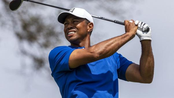 Golf - Tiger, McIlroy winners of their opening rounds at WGC-Match Play