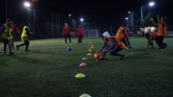 Barca seek to turn Lesbos camps into fields of dreams for child refugees