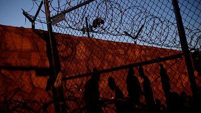 Migrants being held in Texas enclosure as surge overwhelms El Paso