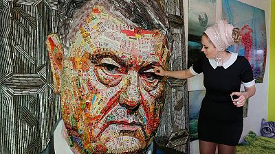Artists use Ukraine president's candy wrappers for critical portrait
