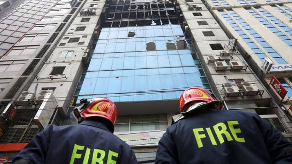 Bangladesh high-rise hit by deadly blaze lacked proper fire exits, official says
