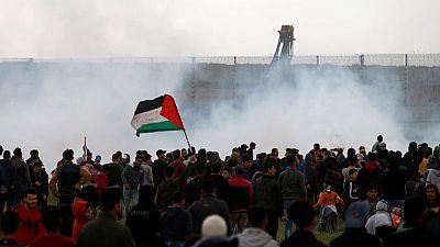 Palestinians mass at Gaza border to mark protest anniversary