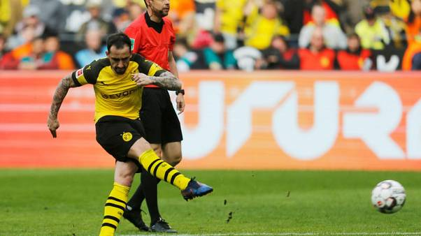 Late Alcacer double sends Dortmund two points clear at top