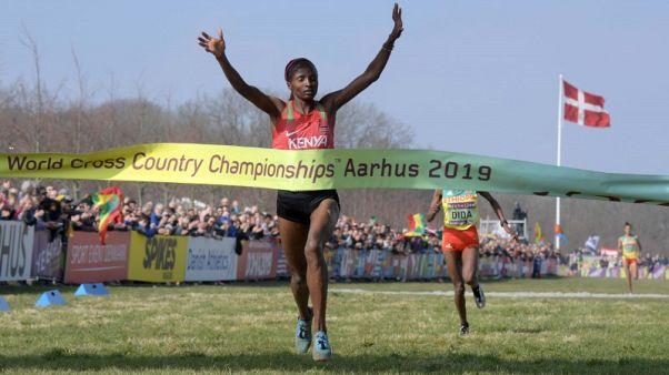 Athletics - Obiri achieves historic world treble at cross country