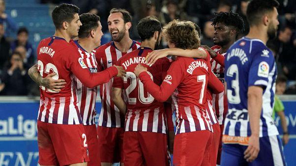 Atletico crush Alaves to retain faint title hopes