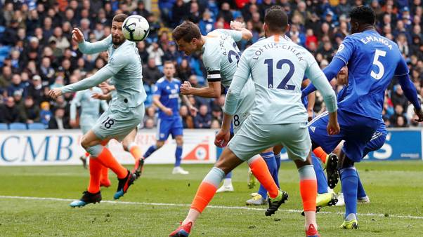 Late goals hand Chelsea thrilling win at Cardiff