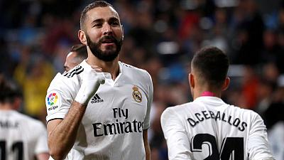 Benzema strikes late to give unconvincing Madrid win over Huesca