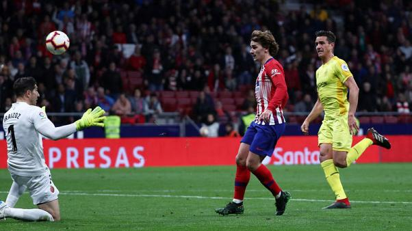 Late strikes from Godin and Griezmann keep Atletico in title chase