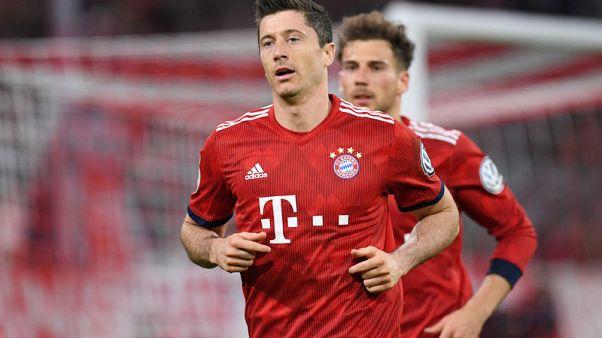 Lewandowski double helps 10-man Bayern edge cup thriller 5-4