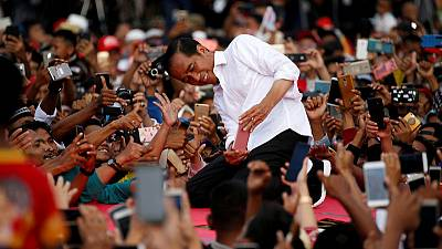 With holograms and breakdancing, a battle for Indonesia's youth vote