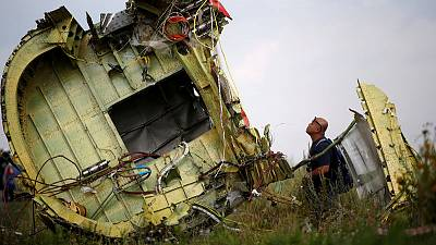 Family of American killed in downed MH17 jet sues Russia banks, money-transfer firms