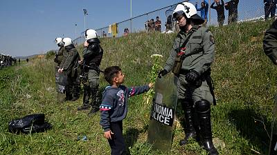 Migrants gather near Greece's northern border, seeking to cross