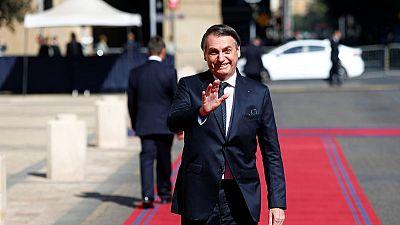 Brazil's Bolsonaro warms to old-style politics to push pension bill