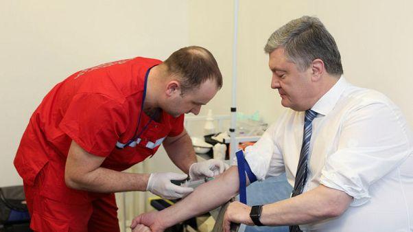 Ukraine presidential rivals undergo televised drug tests