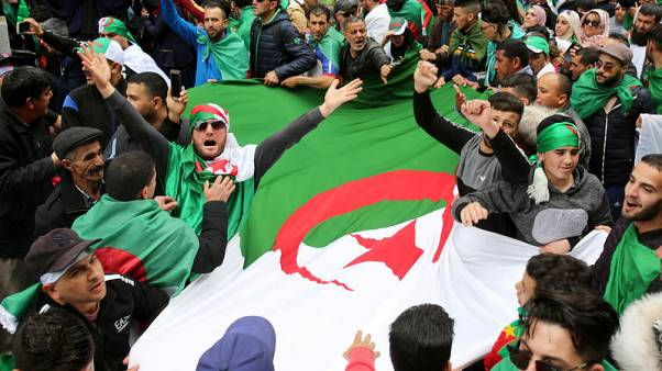 Algerian protesters march again as spy boss reported sacked