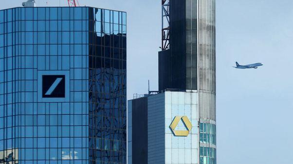 Deutsche, Commerzbank favour merger over holding company structure - sources