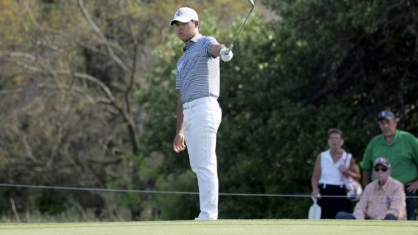 Golf - Hole-in-one powers Kim to four-stroke lead in Texas