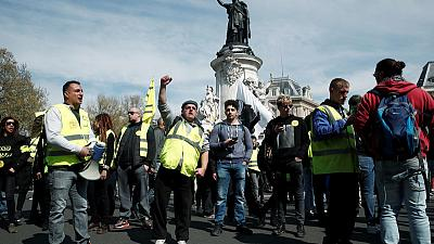 French 'yellow vest' protests largely peacefully as Macron wraps up debate