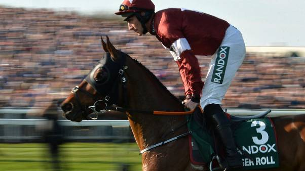Horse Racing - Tiger Roll wins back to back Grand Nationals
