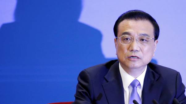 China wants to work with EU on trade, premier writes before summit
