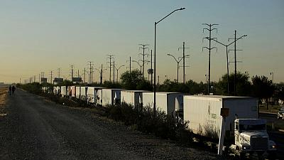 Delays at U.S.-Mexico border crossing hits autos, trucks still lining up