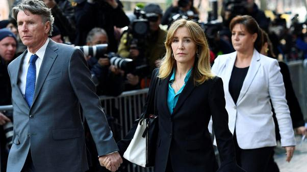 Actress Felicity Huffman, 13 others to plead guilty in U.S. college admissions scandal