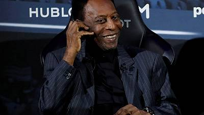 Pele back in Brazil, healthy but undergoing tests