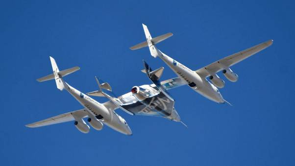 Virgin Galactic's first test passenger gets commercial astronaut wings