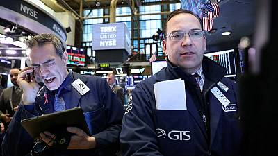 Stocks slide before corporate results, dollar gains