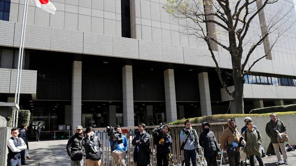 Carlos Ghosn's wife arrives at Tokyo District Court - Kyodo
