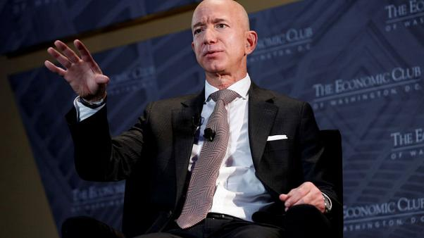 Amazon's Bezos challenges retail rivals to raise minimum wages