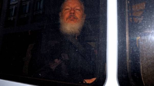 Out of the embassy, straight into custody: Assange's court hearing
