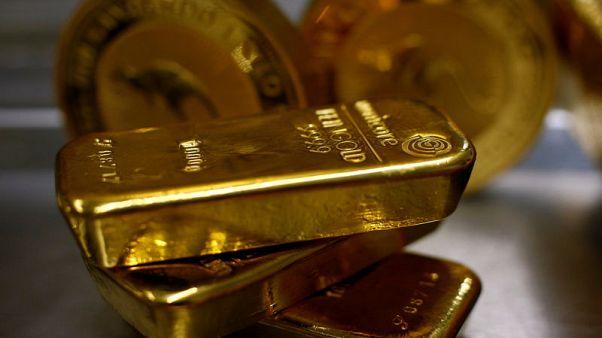 الذهب يتراجع مع انحسار تأثير هبوط الدولار أمام مكاسب الأسهم في بورصة وول ستريت