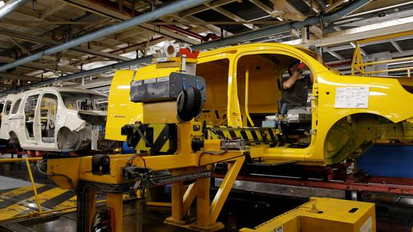 Euro zone industry output falls by less than expected in mild February