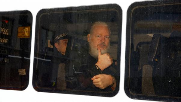 Backstory: A tip-off, a red light - how Reuters captured Assange's thumbs-up