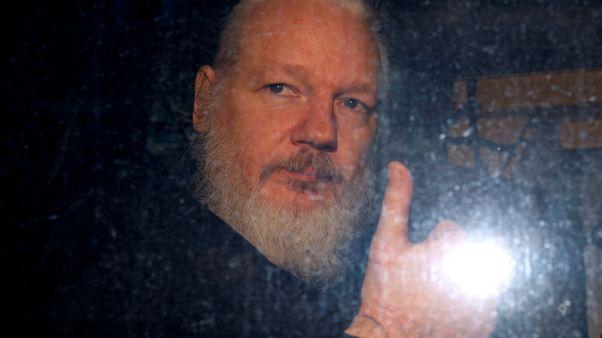 Ecuador holding Swedish programmer linked to Assange in custody