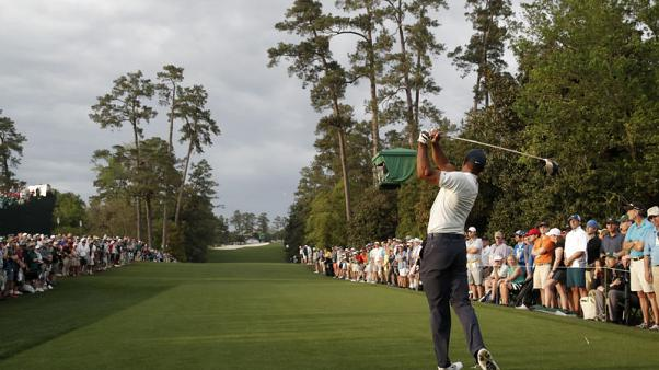 Golf - Masters play suspended due to dangerous weather