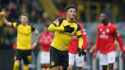 Sancho double sends nervous Dortmund back on top