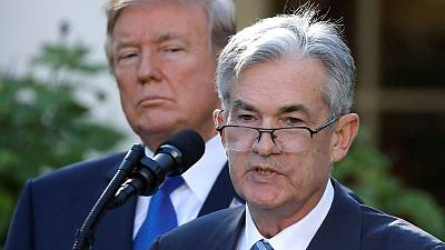 As Trump pressures Powell, Wall Street gives Fed a passing grade