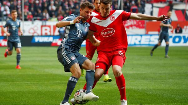 Bayern ease past Duesseldorf 4-1 to reclaim top spot