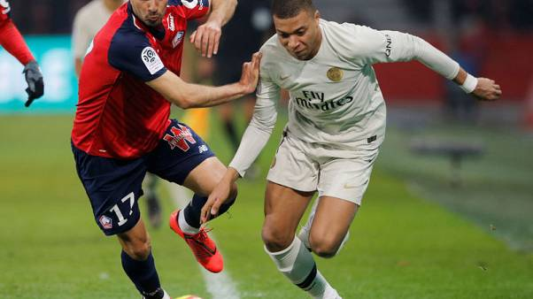 Ten-man PSG humiliated at Lille, made to wait for title
