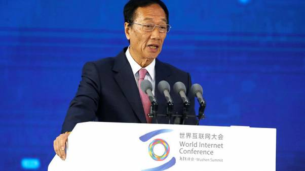 Exclusive: Foxconn chairman says aims to step down to pave way for younger talent