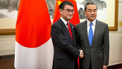 China says Japan should do more to seek cooperation, not competition
