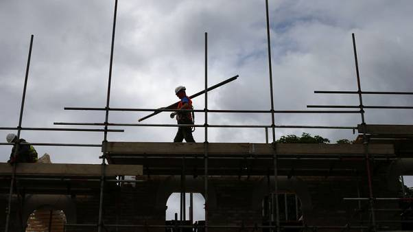 Galliford to review construction business, lowers forecast