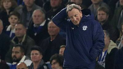 Cardiff's Warnock hopes to avoid thrashing by Liverpool