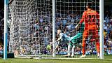 City back on top after tense win over Spurs