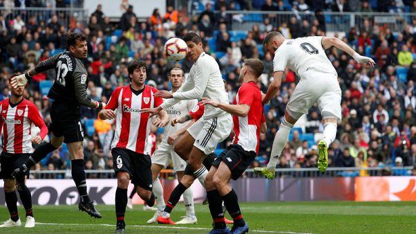 Benzema hat-trick helps Real back to winning ways in La Liga