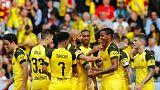 Dortmund crush Freiburg 4-0 to stay on Bayern's heels