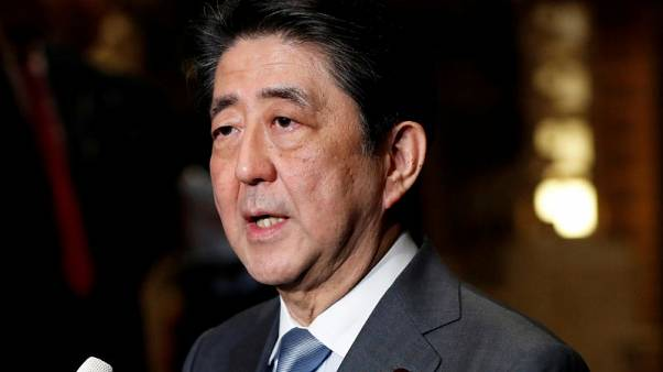 Japan PM Abe's ruling bloc suffers rare losses in two by-elections