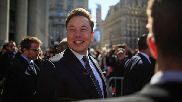 Factbox - Elon Musk on Tesla's self-driving capabilities